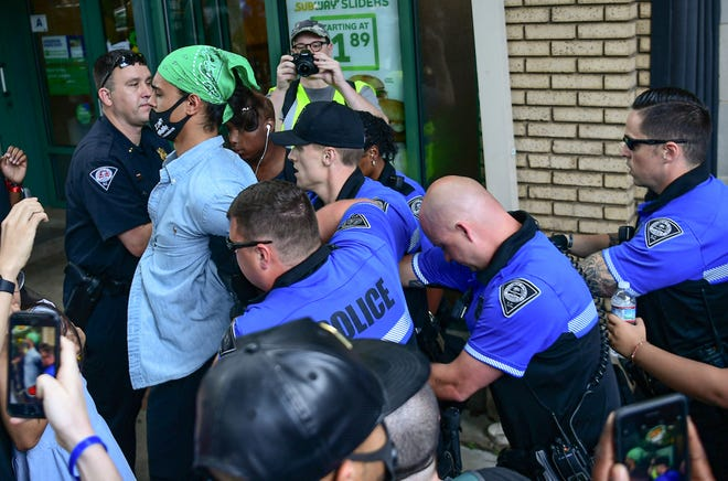 A man is arrested by Greenville police during a protest remembering George Floyd at Falls Park in Greenville Sunday, May  31, 2020.