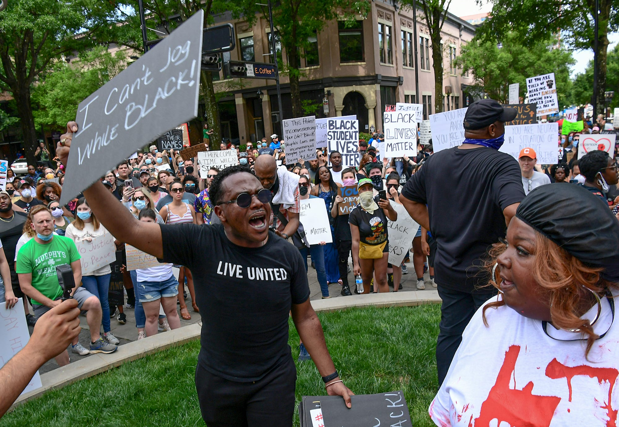 Jay Curenton of Greenville leads a chant during a protest remembering George Floyd at Falls Park in Greenville Sunday, May  31, 2020.