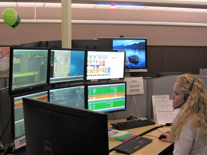 Dispatcher Becky Brubaker works on six screens at once in the Cascade County 911 dispatch center. Cascade County 911 celebrated its 30th anniversary June 1.