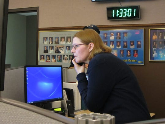 Cascade County 911 Director Karen Young takes a phone call at the dispatch center in Great Falls. Cascade County 911 celebrated its 30th anniversary June 1.