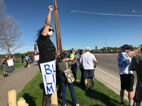 Danielle Elledge of Great Falls was one of a few hundred people who attended a rally Sunday on Central Avenue West in Great Falls to protest the death of George Floyd of Minneapolis, who died in police custody.