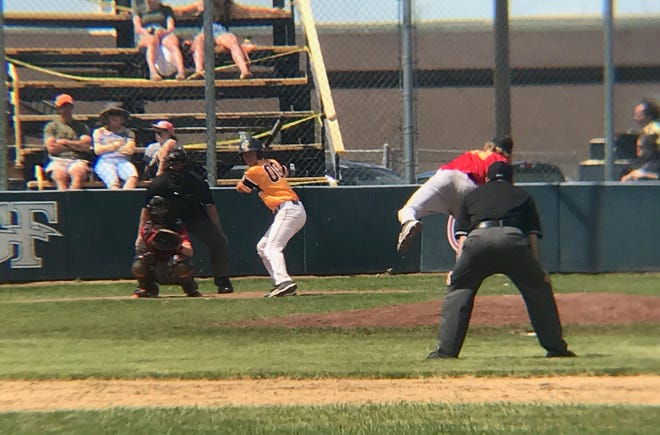 The Chargers' Keeton Clark (00 in yellow) watches the pitch from Kalispell's Danny Kernan in the bottom of the sixth inning, which Clark ripped to the left-center field field for a go ahead double in the Chargers' 13-10 win over the Lakers Sunday at Don Olson Field.