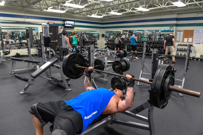 Anthony Banks lifting weights in the strength room as the Henderson County YMCA opens with a Phase 1 distancing plan, allowing members access to the fitness centers, cardio and strength areas, with restrictions on capacity and spacing, June 1, 2020.