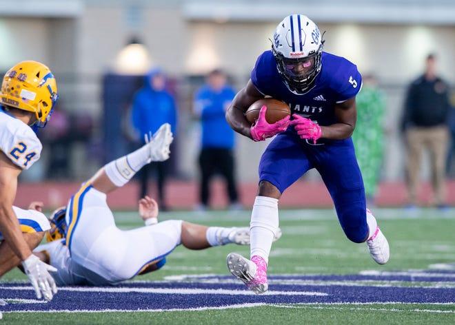 Ben Davis' Daylan Carnell (5) rushes the ball upfield during the first half of an IHSAA high school football game at Ben Davis High School, Friday, Oct. 4, 2019.