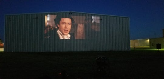 Summer of the Art staff test their screening equipment at the Iowa City Municipal Airport during the last weekend of May 2020. In July, the organization's Free Movie Series will be screened here as a drive-in movie rather than on the Pentacrest where it's traditionally been held.