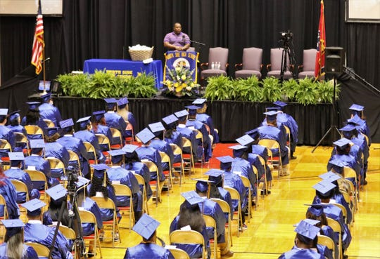 The North Side High School, Class of 2020, have their graduation ceremony in Oman Arena in Jackson, Tenn., Friday, May 22, 2020. The graduating seniors wore their blue gowns along with face masks to implement the social distancing guidelines.