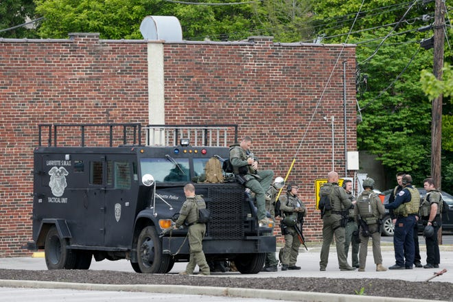 Law enforcement stages in a parking lot, Monday, June 1, 2020 in Lafayette.