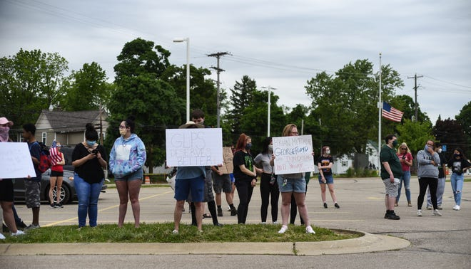 A group protests Monday, June 1, 2020, outside the Grand Ledge Community Schools administration building.  They are rallying about Facebook comments Superintendent Brian Metcalf made about George Floyd.