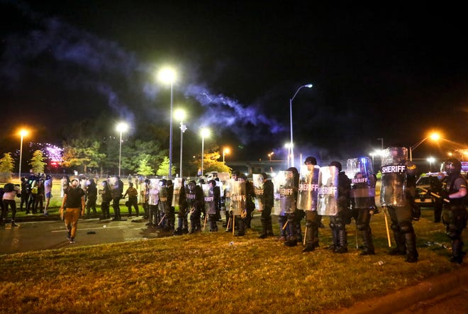 Shelby County Sheriff deputies fire tear gas over their line and into the crowd of protesters amidst a confrontation during a protest against police brutality and the death of George Floyd downtown Memphis, Tenn., on Sunday, May 31, 2020.