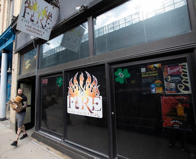 Owner Adam Griffin removes belongings from his bar and lounge, Fire On Water on Monday at 518 N. Water St. in Milwaukee. Griffin, whose lease was up in June, blames the pandemic for its closure and knows of several other venues that are close to shutting down.