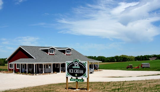 The Kelley Country Creamery is shown less the porch rocking chairs.