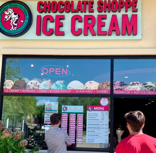 The Chocolate Shoppe outlet in Fitchburg is shown keeping customers outdoors.