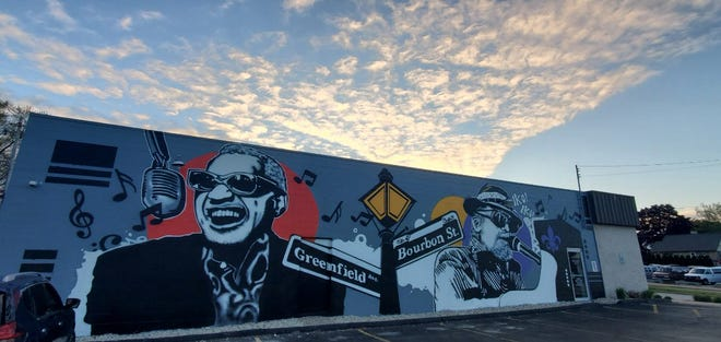 A colorful mural featuring musicians Ray Charles and Dr. John now adorns the east-facing wall at Crawdaddy's on Greenfield in West Allis. The mural was painted by artist Michael Ortiz of Denver.