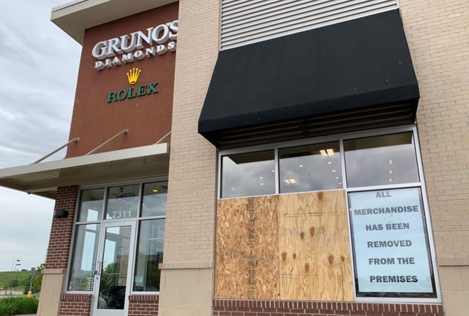 Gruno's Diamonds on the west side of Madison tries to deter looters after windows were smashed over the weekend.