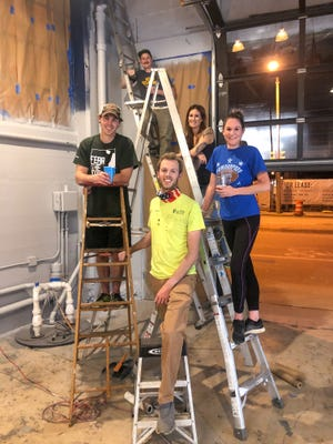 The founding team for New Barons Brewing Cooperative begin renovations on a permanent home. They include, from left,  Mike Mack, John Degroote, Heidi Dalibor, Sarah Hand and Matt Witterschein, in front.