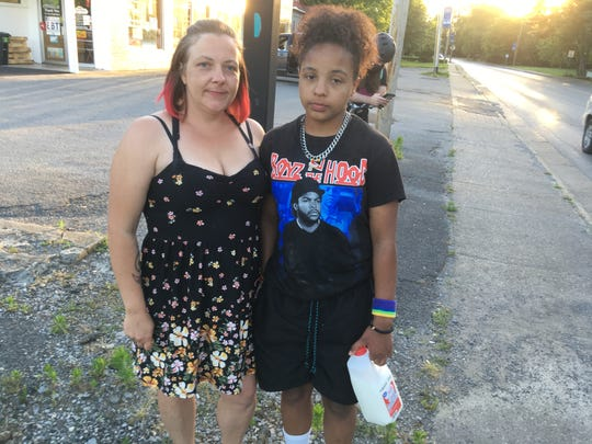 Crystal Mai and her 12-year-old daughter, Lariah Daniels, said they were hit by tear gas thrown by police officers in Murfreesboro on May 31, 2020. The pair used milk from a corner store to ease the sting.