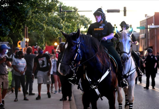 The Rutherford County Sheriff's Department uses the mounted patrol to move protesters back from the square and threatened that they will be arrested for breaking curfew after a protest rally held on Murfreesboro's Public Square Sunday, May 31, 2020 in response to the death of George Floyd.