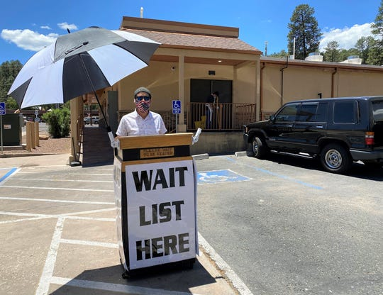 Owner Steve Gomez of the Cornerstone Bakery Cafe, greets guests in the parking lot in order to maintain safe, physical distancing in the entryway to the restaurant on June 1.