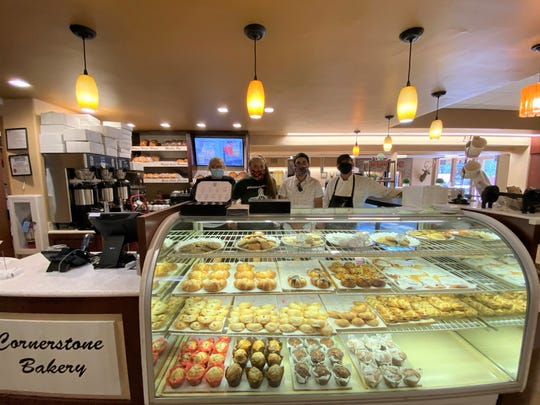 Staff at Cornerstone Bakery Cafe, make certain everything is in order as they prepared for indoor dining on June 1.