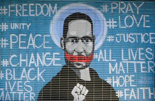 Ein Wandgemälde mit George Floyd ist während eines Protestes gegen den Tod von Floyd am Sonntag, dem 31. Mai 2020, in Los Angeles zu sehen. Floyd starb am 25. Mai in Minneapolis, nachdem er von einem Polizisten am Hals festgehalten worden war.