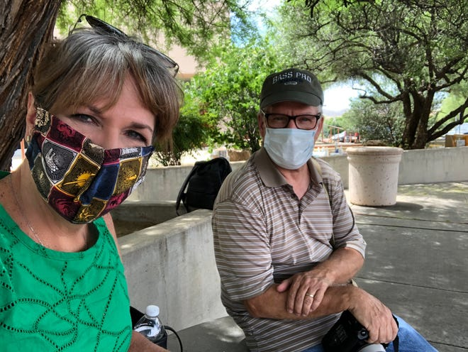 Karina Bland and photographer Mark Henle in Miami, Ariz., working on a story about how the small town is managing the pandemic.
