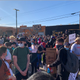 "There appears to be more than 100 people, many wearing masks and holding signs including ""I can't breathe"" and ""Justice for Dion Johnson"" at a protest in downtown Phoenix on May 31, 2020."