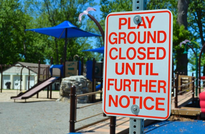 A sign at Lakeview Park in Port Clinton warns visitors that the park is temporarily closed due to COVID-19 concerns. When the polio epidemic swept through the city in 1948, the county health official refused to shutter the town. Schools, playgrounds and businesses remained open. The first fatality occurred in July and by September, newspaper headlines announced that the epidemic was believed to be under control.