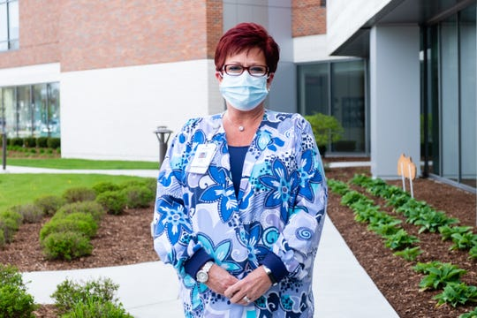 McLaren Port Huron Director of Medical Imaging Services Kim Chaltry poses for a portrait Tuesday, May 19, 2020, outside the hospital. Since the coronavirus pandemic hit, one of her main responsibilities in the hospital has been meeting with hospital staff and helping to address their fears and concerns.