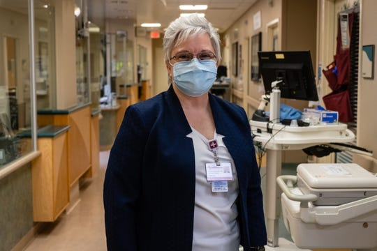 Denise Parr, Lake Huron Medical Center's infection prevention specialist, poses for a portrait Friday, May 15, 2020, in the hospital's emergency department. Parr works with hospital staff to train them on proper use of their PPE, as well as helping to create workflows to keep them safe.