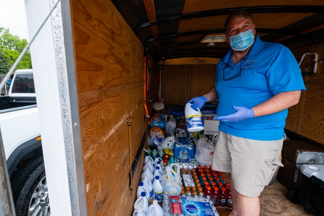 Pat Coughlin, of Coughlin Jewelers, talks about supplies they've collected to donate to flooding relief efforts Friday, May 29, 2020, in a trailer outside the store in St. Clair. Once or twice a week he takes donated materials  to Sanforddistribution points like the local fire department and elementary school.