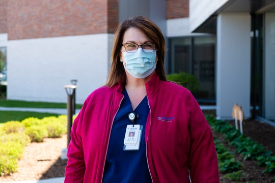 Kelly DiNardo, community outreach and education specialist at McLaren Port Huron, poses for a photo Wednesday, May 20, 2020, outside the hospital. Before the pandemic, DiNardo oversaw all outreach and programming efforts, such as support groups, health screenings and educational classes.