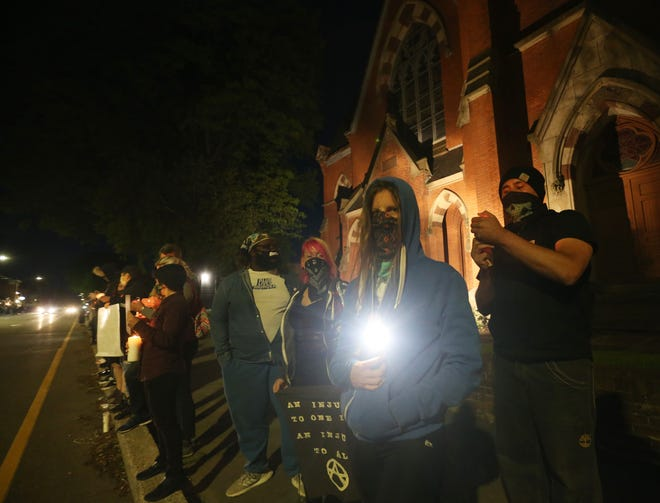 Scenes from Sunday night's candlelight vigil for George Floyd in the City of Poughkeepsie on May 31, 2020.