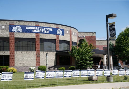 Signs for each graduate line the grounds of Beacon High School during Monday's graduation celebratory walk ceremony on June 1, 2020.