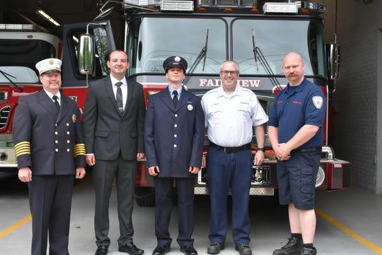 In front of the Fairview Fire Station,  Deputy Chief Gilnack , Firefighter Chris Hann, Volunteer Firefighter/EMT Jake Lawlor , Lt. EMT Robert Ridley, Firefighter Tom Tompkins.