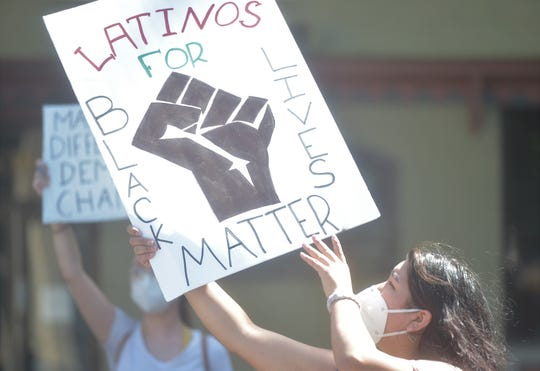 """A protest demanding justice for George Floyd remained peaceful Monday afternoon, June 1, 2020, in downtown Chambersburg.  Andrea Piña-Contreras, of Chambersburg, wanted to show solidarity between the Hispanic and black communities. """"I just wanted to speak out for the Latino community,"""" she said. """"I think it's important that we are all in this together. It's insane that the world has to be so separated. It's crazy."""""""