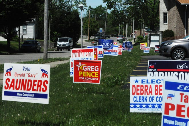 Candidate signs line the grass between the sidewalk and parking lot of Mt. Olive Baptist Church in Richmond on Monday, June 1, 2020.