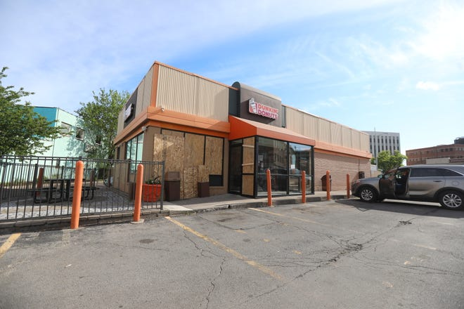 Dunkin' Donuts on Monroe Avenue was damaged over the weekend and broken windows were covered by plywood on June 1, 2020.