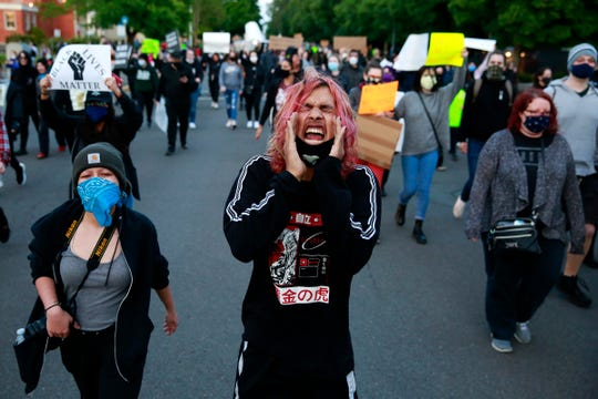 Jacob Hernandez of Salem leads a chant during a protest in Salem, Oregon, on Sunday, May 31, 2020. Demonstrators were protesting the death of George Floyd, who died in police custody on May 25 in Minneapolis.