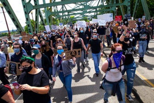 Thousands walk over the Ferry Street Bridge in Eugene, during a Black Live Matter March on May 31, 2020, about the deaths of George Floyd and others.
