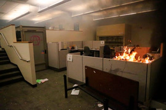In this March 29, 2020, photo, a fire burns in an office in Portland burns during protests in response to the Minneapolis death of George Floyd.