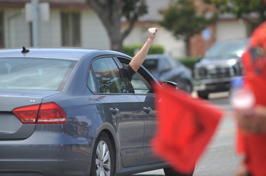 A passerby holds a fist up out of a passenger window in support of protesters at Hartnell College. June 1, 2020.