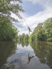 Luke Kemp enjoys the view from a rope swing before plunging into the upper Choptank River.