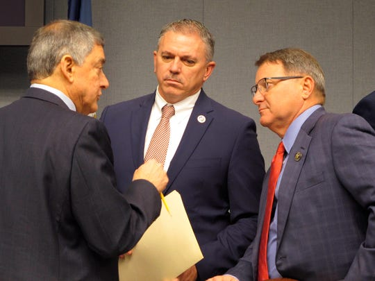 In a Feb. 7, 2020 file photo, Commissioner of Administration Jay Dardenne, the governor's chief budget adviser, left; House Speaker Clay Schexnayder, R-Gonzales, center; and Senate President Page Cortez, R-Lafayette, speak ahead of a meeting of Louisiana's income forecasting panel in Baton Rouge. Louisiana's income forecasting panel planned to quantify on Monday, May 11, 2020 just how deeply the coronavirus outbreak has hurt the state's economy as officials begin to put together next year's budget.