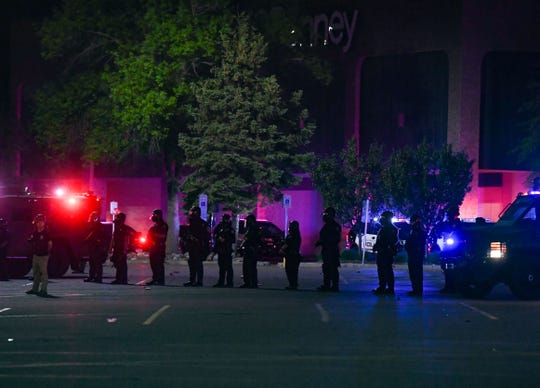 Police form a line outside the Empire Mall to deter protesters on Sunday, May 31, in Sioux Falls.