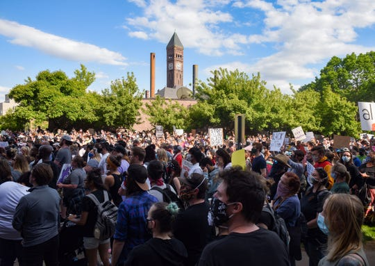 Hundreds of protestors march downtown to demand justice for George Floyd, joining nationwide protests on Sunday, May 31, in Sioux Falls.