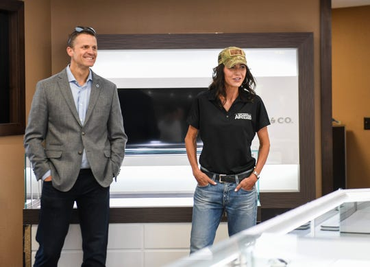 Mayor Paul TenHaken and Gov. Kristi Noem survey the damage done to businesses after Sunday's protests turned violent on Monday, June 1, 2020 at Riddle's Jewelry in Sioux Falls, S.D.