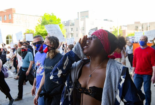 Christelle Yougbare yells during a protest to demand justice for George Floyd, joining nationwide protests on Sunday, May 31, in Sioux Falls.