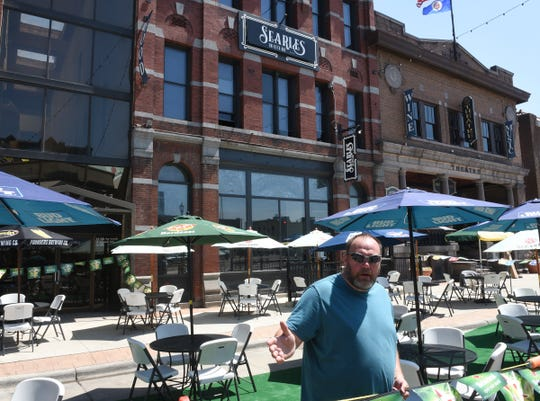 Darin Agnew, one of the owners of Searles on Fifth Ave, speaks about new outdoor seating Monday, June 1, 2020, in St. Cloud.