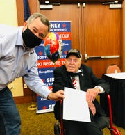 St. George Mayor Jon Pike, left, met with Sidney Walton, a World War II veteran, on the 101-year-old's way to Salt Lake City during a nationwide tour meeting with state governors and other leaders.