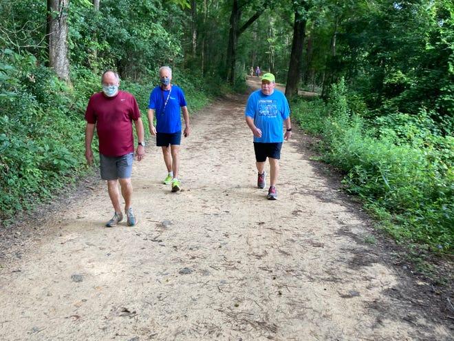 Bill Lott, left,  Ken Misner and  Tom Perkins take the shady trail.